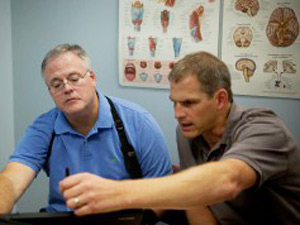 Neurofeedback therapist helps stroke patient