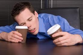 Sleepy guy with 2 coffees
